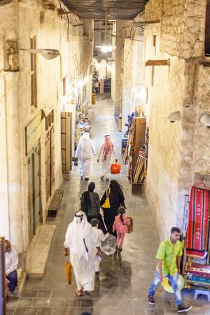 thoub: DOHA, QATAR - NOV 19: Qatari people shopping at the traditional market Souq Waqif. November 19, 2015 in Doha, Qatar, Middle East