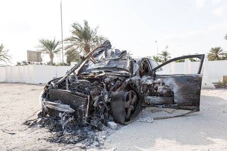 out of body: Burnt out body of a luxury car