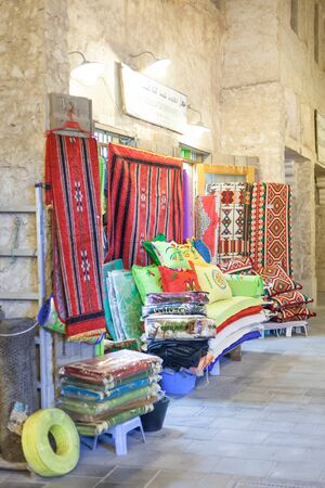 souq: DOHA, QATAR - NOV 19: Textile shop at the traditional market Souq Waqif. November 19, 2015 in Doha, Qatar, Middle East