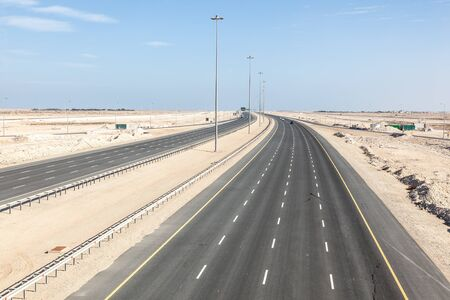 one lane: New multiple lane highway number one connection the cities of Al Ruwais and Doha. Qatar, Middle East Stock Photo