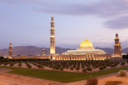 sultan: The Sultan Qaboos Grand Mosque illuminated at dusk. Muscat, Oman, Middle East