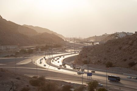 muttrah: Muscat Expressway backlit from the sun in the afternoon. Muscat, Sultanate of Oman