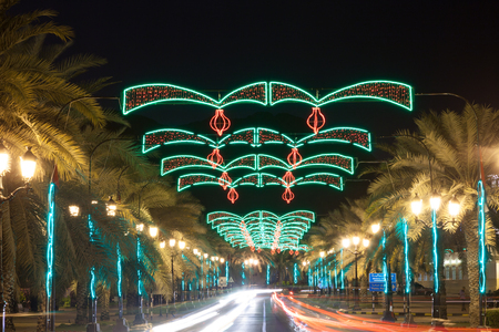 muttrah: MUSCAT, OMAN - NOV 24: Street in Muscat decorated with chains of lights for celebration of the 45th National Day of Oman. November 24, 2015 in Muscat, Sultanate of Oman, Middle East