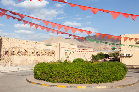 roundabout: Green roundabout at the fort of Nizwa. Sultanate of Oman, Middle East