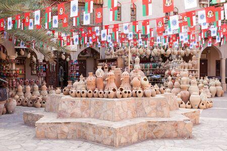 artisanry: NIZWA, OMAN - NOV 25: Terracotta and ceramic pottery at the Nizwa souk. November 25, 2015 in Nizwa, Sultanate of Oman, Middle East