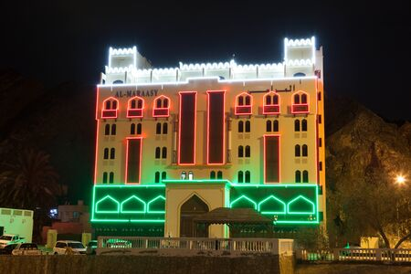 muttrah: MUSCAT, OMAN - NOV 24: Al Maraasy hotel in Muscat illuminated at night. November 24, 2015 in Muscat, Sultanate of Oman
