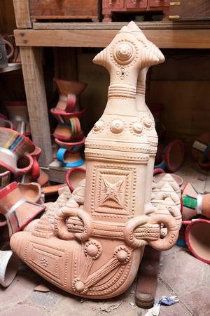 artisanry: Terracotta Omani khanjar dagger for sale in Nizwa souk. Sultanate of Oman, Middle East