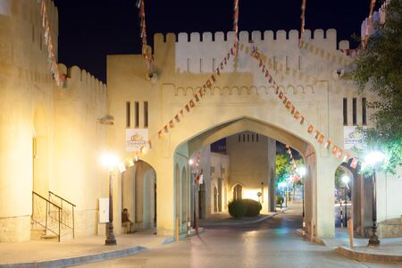 east gate: NIZWA, OMAN - NOV 25: Gate to the old town of Nizwa illuminated at night. November 25, 2015 in Nizwa, Sultanate of Oman, Middle East