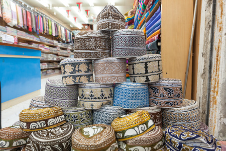muttrah: Traditional omani kuma hats for sale at the souq in Muscat. Sultanate of Oman, Middle East