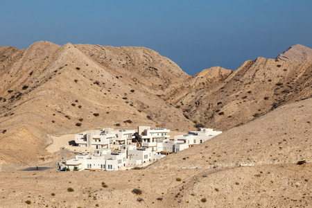 urbanization: Small urbanization in the mountains near Muscat, Sultanate of Oman, Middle East Stock Photo