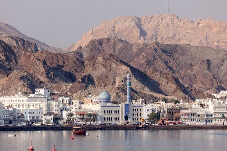 muttrah: MUTTRAH, OMAN - NOV 29: Waterfront buildings at the corniche of Muttrah, the old town of Muscat. November 29, 2015 in Muttrah, Sultanate of Oman, Middle East