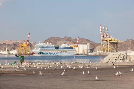 muttrah: MUSCAT, OMAN - NOV 29: German cruise ship AIDA stella in the port of Muscat. November 29, 2015 in Muscat, Sultanate of Oman
