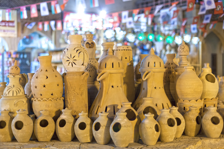 artisanry: Terracotta pots for sale in Nizwa souk at night. Sultanate of Oman, Middle East