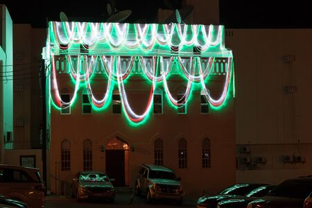 muttrah: Colorful illuminated building in the old town of Muttrah. Sultanate of Oman, Middle East