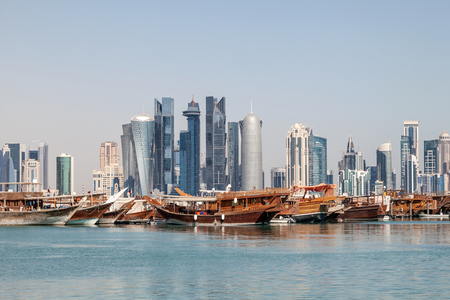 Doha city skyline with the old dhow harbor in foreground. Qatar, Middle East