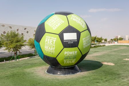 slogans: DOHA, QATAR - NOV 20: Football with slogans at the Doha Education City. November 20, 2015 in Doha, Qatar, Middle East