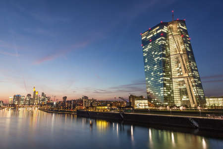 central european: European Central Bank and the skyline of Frankfurt Main downtown at night, Germany Editorial