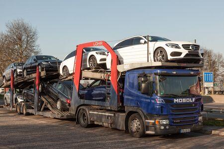 autos: FRANKFURT, GERMANY - MAR 14: Car transporter truck with new Mercedes Benz cars. March 14, 2016 in Frankfurt Main, Germany
