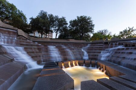 worth: FORT WORTH, TX, USA - APR 6: The Water Gardens in the city of Fort Worth at dusk. April 6, 2016 in Fort Worth, Texas, USA
