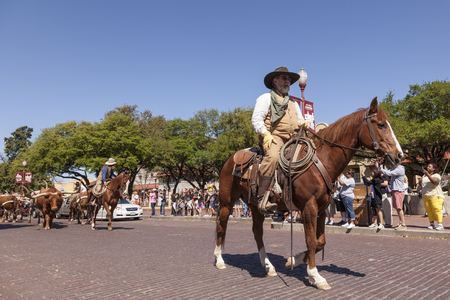 fort worth: FORT WORTH, TX, USA - APR 6: Cowboys in the Fort Worth Stockyards historic district. April 6, 2016 in Fort Worth, Texas, USA