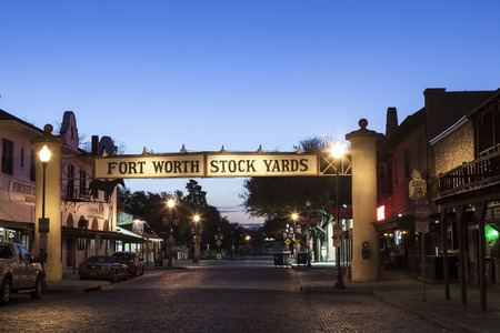 FORT WORTH, TX, USA - APR 6: Street in the Fort Worth Stockyards district illuminated at dusk. April 6, 2016 in Fort Worth, Texas, USA Editorial