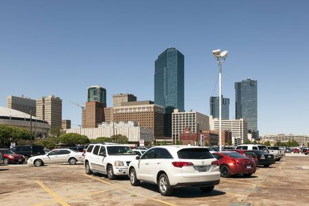 worth: FORT WORTH, USA - APR 6: Cars on a parking lot in Fort Worth downtown district. April 6, 2016 in Fort Worth, Texas, USA