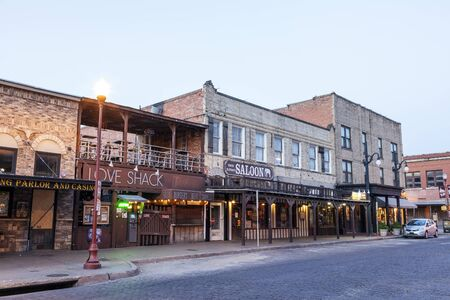 worth: FORT WORTH, TX, USA - APR 6: Street in the Fort Worth Stockyards district illuminated at dusk. April 6, 2016 in Fort Worth, Texas, USA Editorial