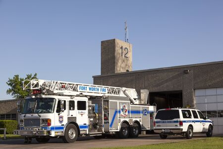 worth: FORT WORTH, USA - APR 6: Fort Worth Fire Truck in front of the firehouse. April 6, 2016 in Fort Worth, Texas, USA