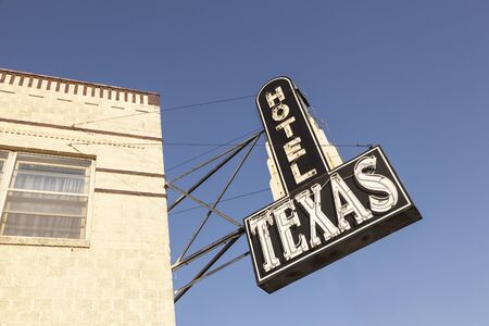 worth: FORT WORTH, USA - APR 6: Hotel Texas sign in the Fort Worth Stockyards historic district. April 6, 2016 in Fort Worth, Texas, USA Editorial