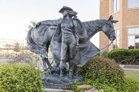 fort worth: FORT WORTH, TX, USA - APR 6: Cowgirl Statue at the National Cowgirl Museum and Hall of Fame in Fort Worth. April 6, 2016 in Fort Worth, Texas, USA