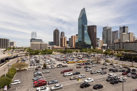 wells: DALLAS, USA - APR 7: Wells Fargo Bank building and a parking lot in Dallas Downtown. April 7, 2016 in Dallas, Texas, United States