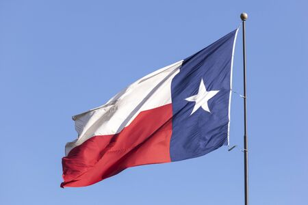 houston flag: State flag of Texas against blue sky. United States of America Stock Photo