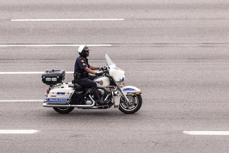 motorcycle officer: DALLAS, USA - APR 8: Motorcycle policeman from Dallas Police Department. April 8, 2016 in Dallas, Texas, United States Editorial