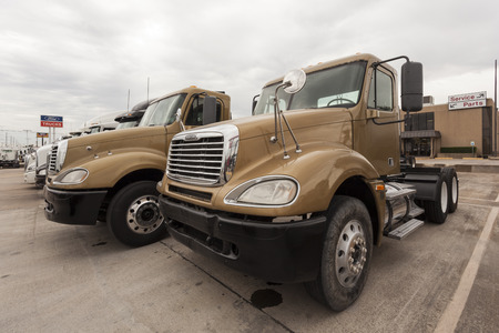 freightliner: DALLAS, USA - APR 9: New Freightliner Flatbed Trucks at the dealership. April 9, 2016 in Dallas, Texas, United States