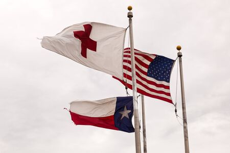 red cross: Flags of the USA, State of Texas and Red Cross waving in the wind Stock Photo