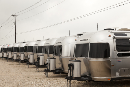 airstream: AUSTIN, USA - APR 11: Row of new luxury american Airstream trailers at a dealership in Texas. April 11, 2016 in Austin, Texas, United States Editorial