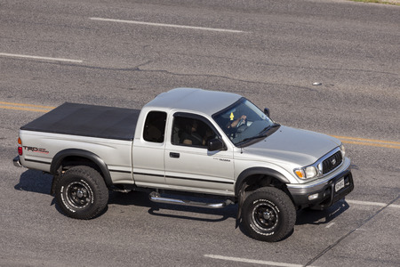 tacoma: AUSTIN, USA - APR 11: Toyota Tacoma TRD off road pickup truck on the street in Austin, Texas. April 11, 2016 in Austin, Texas, United States Editorial