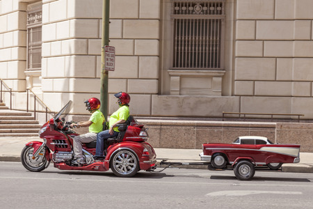 three wheeler: SAN ANTONIO, USA - APR 11: Couple on the Honda Goldwing trike with a trailer. April 11, 2016 in San Antonio, Texas, United States Editorial