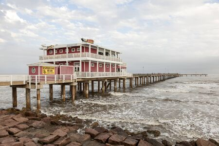 gulf of mexico: GALVESTON, USA - APR 13: Fishing and leisure pier at the Gulf of Mexico coast in Galveston Island. April 13, 2016 in Galveston, Texas, United States Editorial