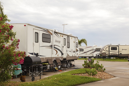 camping site: GALVESTON, USA - APR 12: Trailvers and Recreational Vehicles at a camping site at the Galveston Bay. April 12, 2016 in Galveston, Texas, United States
