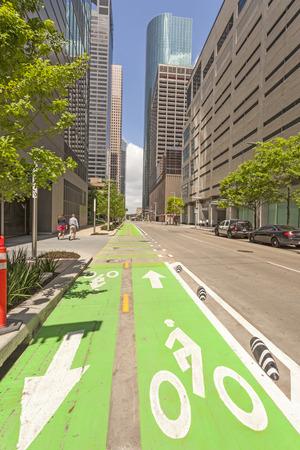 bikeway: HOUSTON, USA - APR 14: Green bikeway in Houston downtown district. April 14, 2016 in Houston, Texas, United States