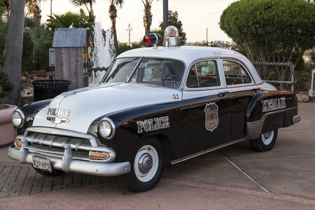 chevrolet: KEMAH, TX, USA - APR 14, 2016: 1952 Chevrolet Styleline Deluxe historic police car of the Kemah Boardwalk police department. Editorial