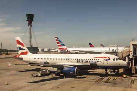 airways: LONDON, UK - APR 20, 2016: British Airways airplanes at the terminal of London Heathrow international airport. Hillingdon, England, United Kingdom. Editorial