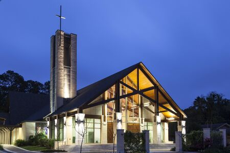 apostle: BATON ROUGE, USA - APR 15, 2016: St. Jude the Apostle Catholic Church in Baton Rouge illuminated at night. Louisiana, United States