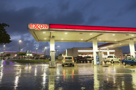 DALLAS, Tx, USA - APR 17, 2016: Exxon gas station illuminated at night. Dallas, Texas, United States