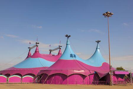 big top: Colorful circus big top tent against a blue sky