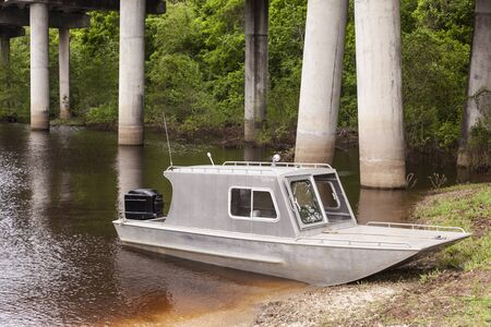 Aluminium fishing boat in a swamp in Louisiana, United States