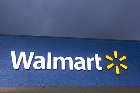 DALLAS, TX, USA - APR 17, 2016: Walmart supercenter sign illuminated at night. Walmart is an American retail company with over 11.500 stores in 28 countries.