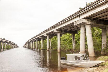 bayou: Aluminium fishing boat in a swamp in Louisiana, United States