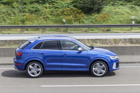 FRANKFURT, GERMANY - JULY 12, 2016: Blue AUDI Q3 luxury SUV driving on the highway in Germany